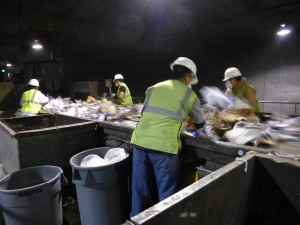 see the workers moving at a frenetic pace to pull out the stuff that didn't belong in the recycling bin.